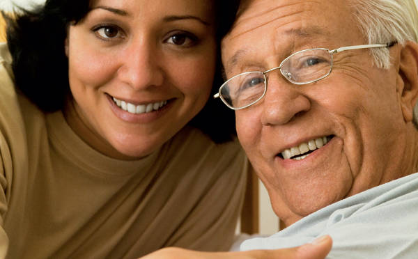 female caregiver with senior male
